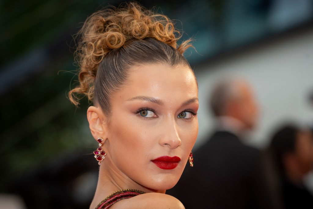 Bella Hadid at Cannes 2019 with a slightly lighter hair color than her typical dark hue